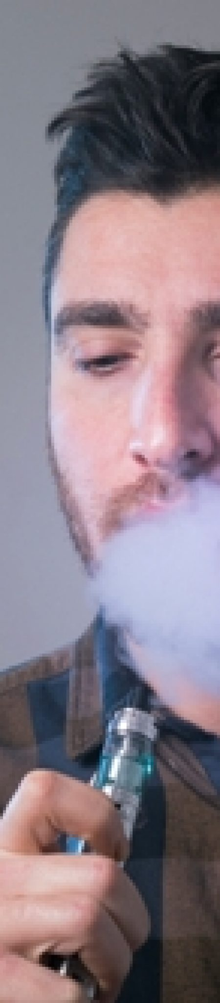 Man-vape-an-electronic-cigarette-with-lots-of-smoke E-cigarettes and Oral Health
