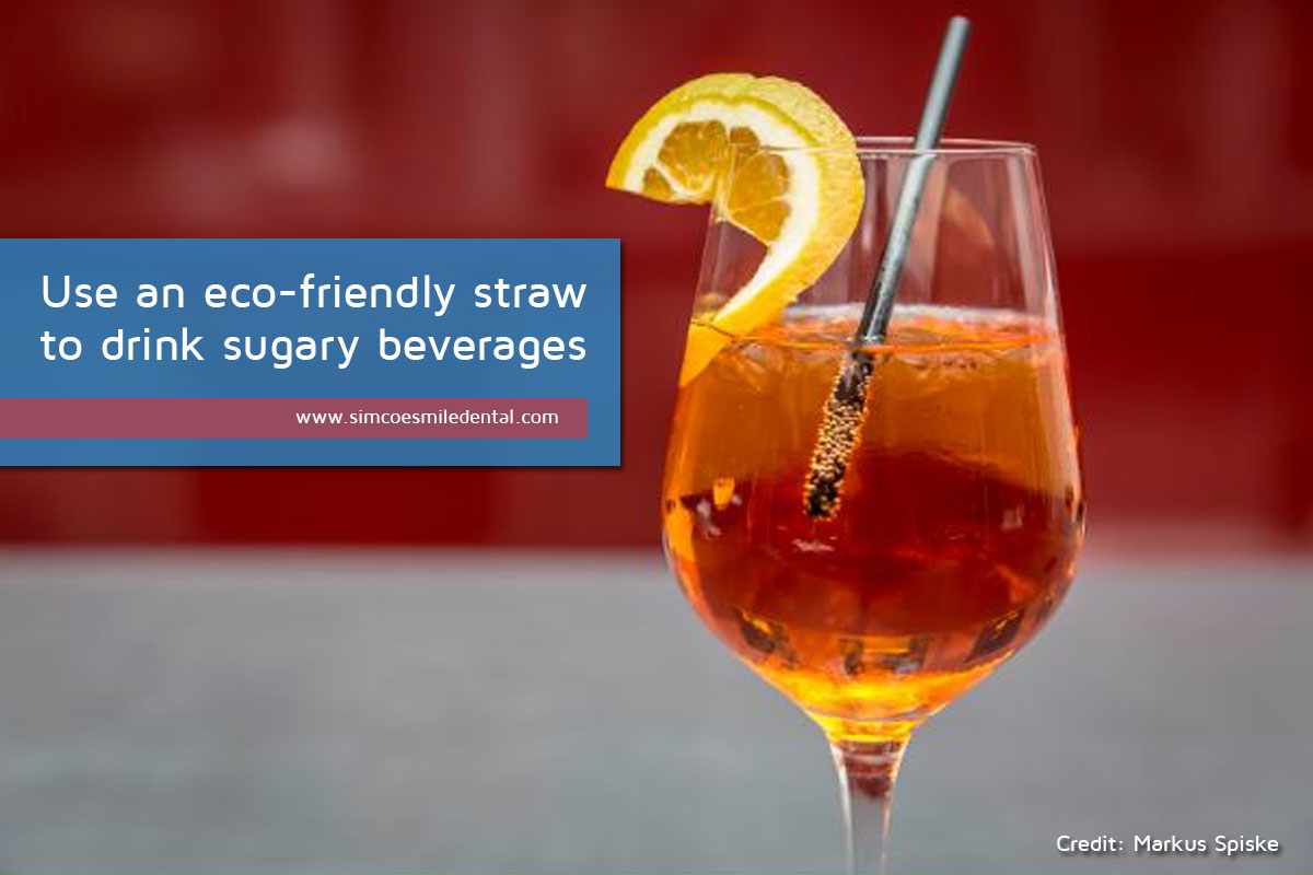Use-an-eco-friendly-straw-to-drink-sugary-beverages Practical Strategies for the Care of Sensitive Teeth